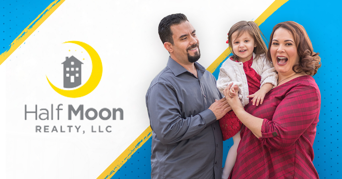 Owners of Half Moon Realty holding their child