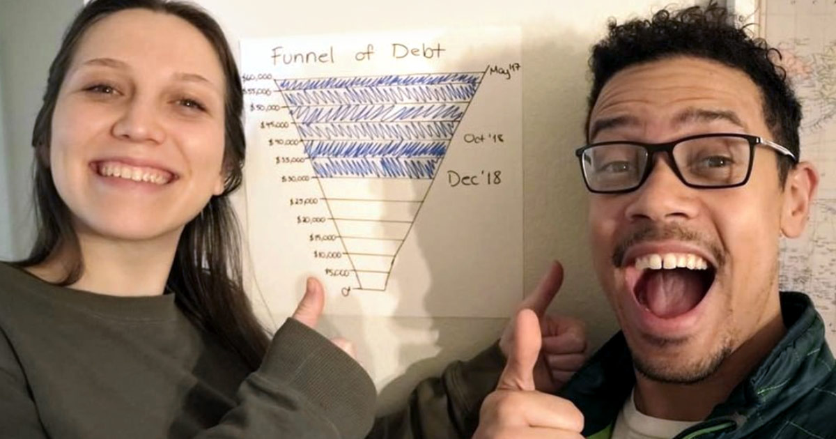 An excited couple shows their progress in paying down debt.