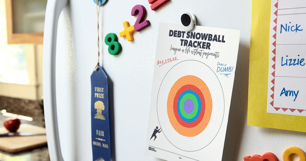 Debt Snowball Tracker posted note hanging on a fridge