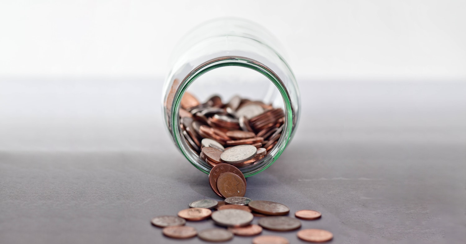 Jar of coins spilling out