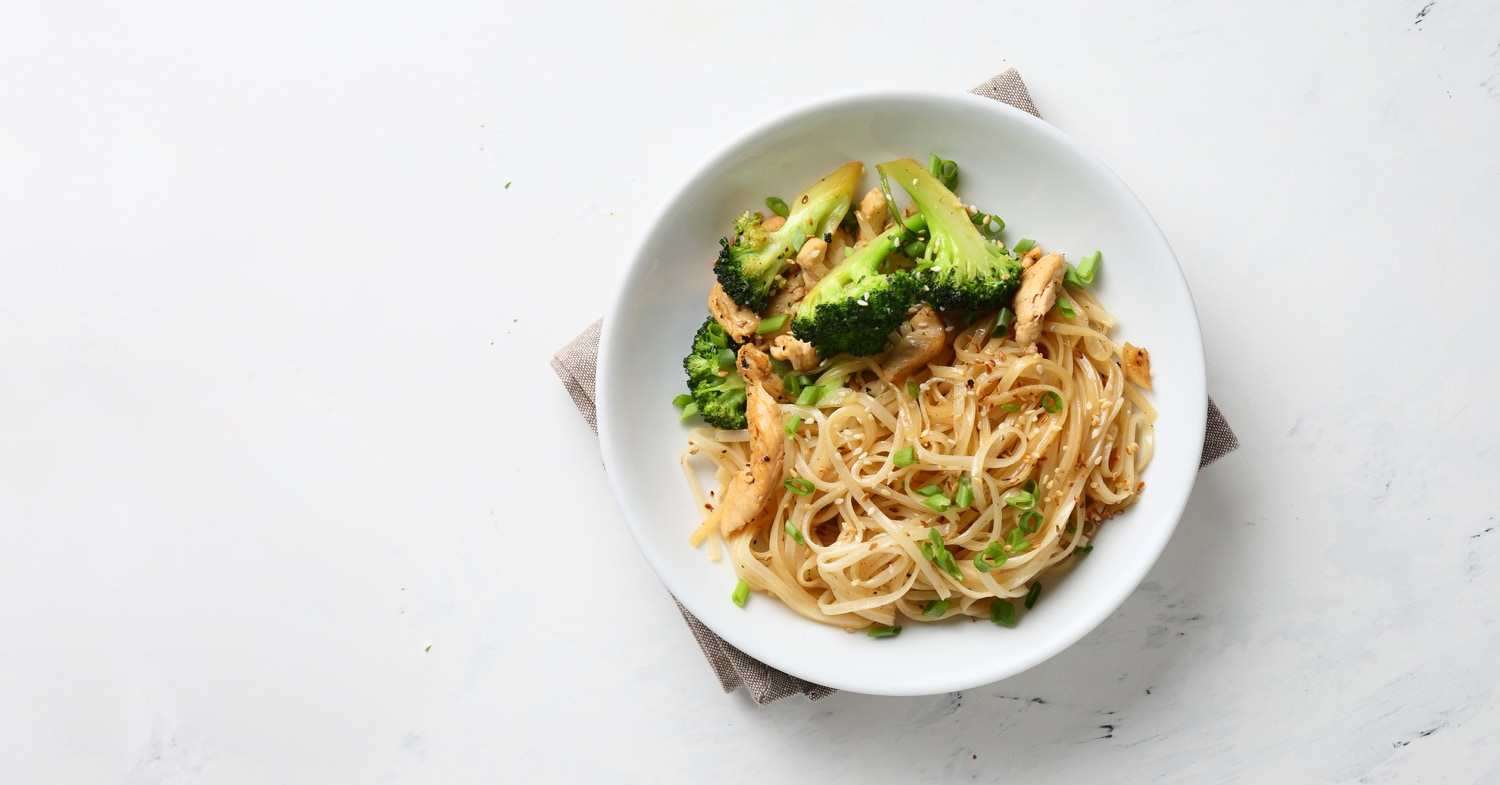 Bowl of pasta with chicken and broccoli