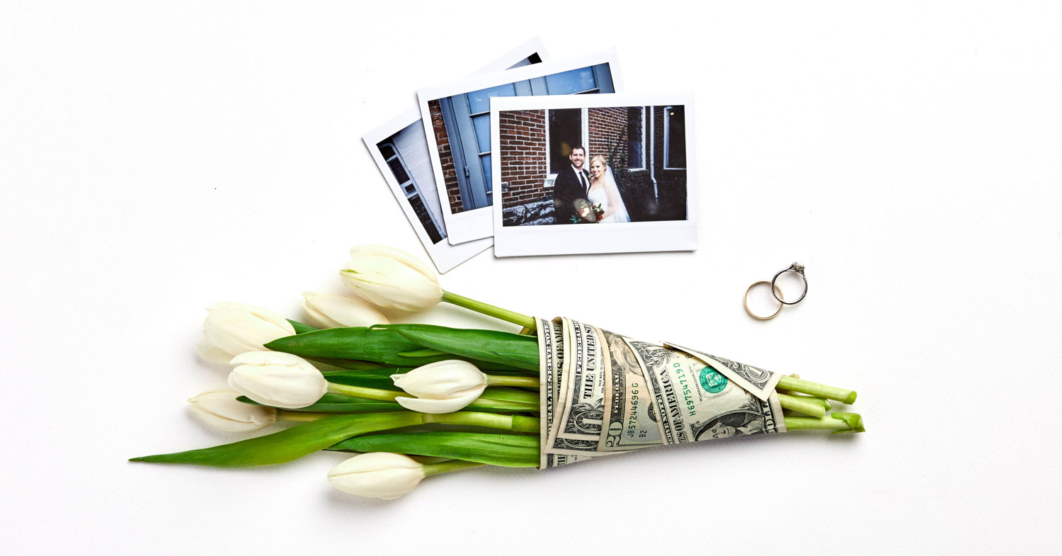 A photo of wedding rings and a bouquet wrapped in dollar iblls
