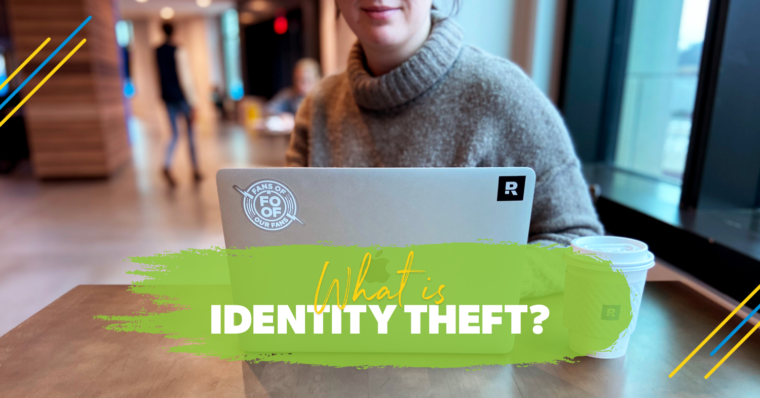 A woman is using her computer to find out about identity theft.