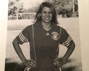 Christy in a soccer uniform