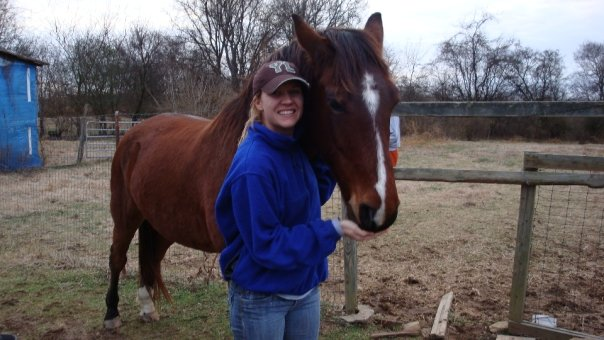 Christy Wright smiling with horse