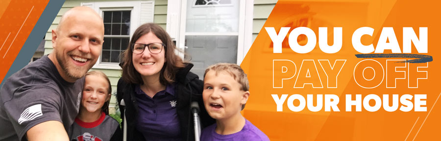 A picture of Kasey and Noah and their family in front of their paid-for home.
