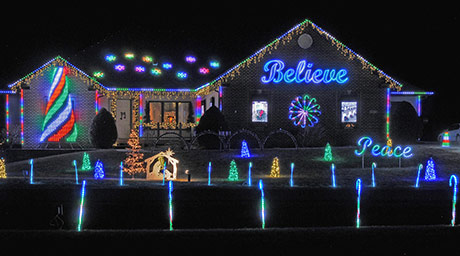 An image of the Christmas light show that Aaron and Deb host every year.
