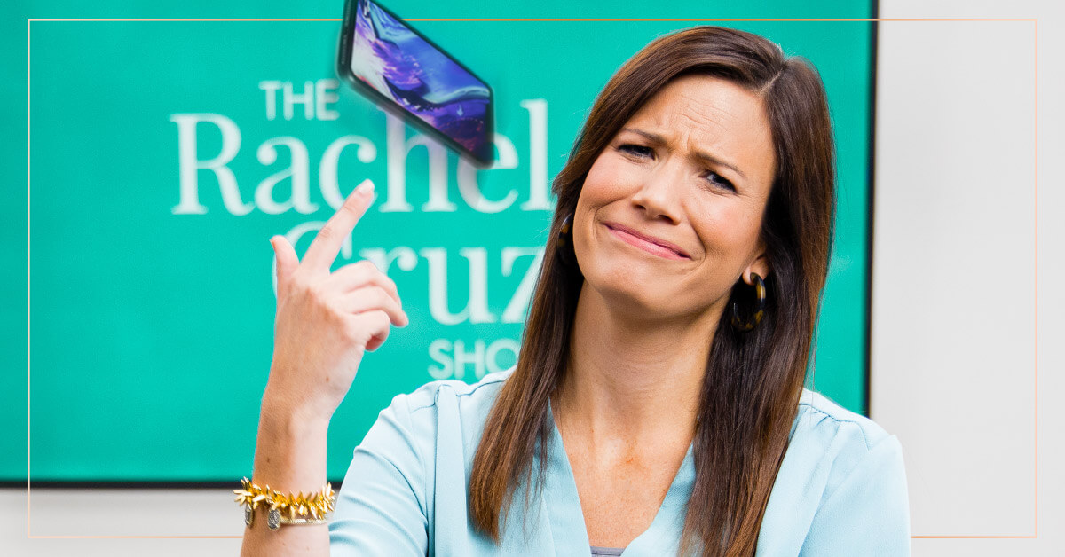 Rachel Cruze throwing a cell phone over her shoulder.