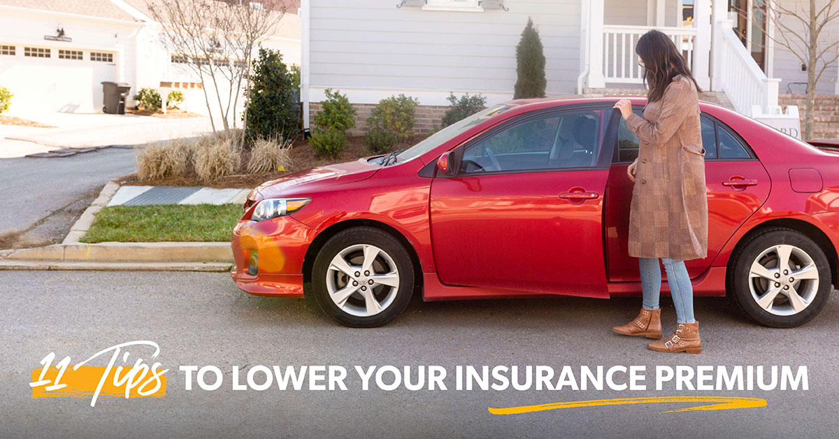 A woman looking at her car wondering about how to save money on insurance premiums.
