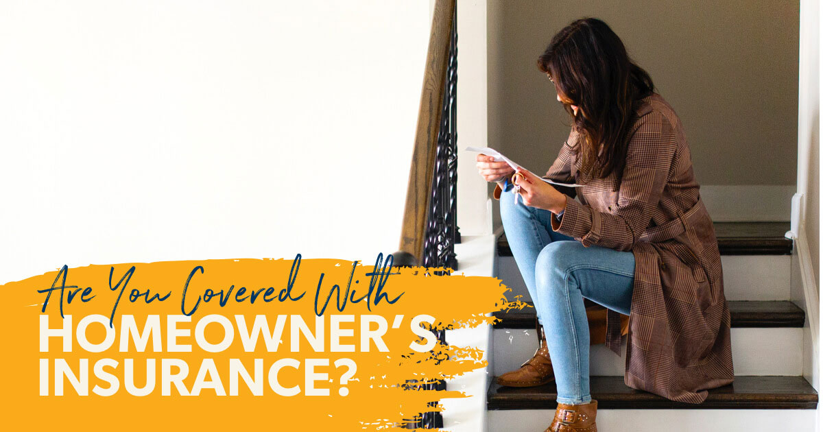 A woman sitting on her stairs reading about what is protected and what is not protected by her home insurance.